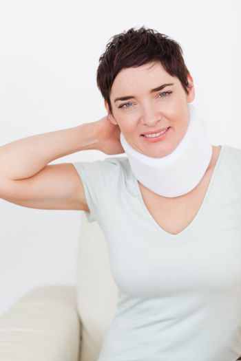 Close up of a brunette woman with a surgical collar