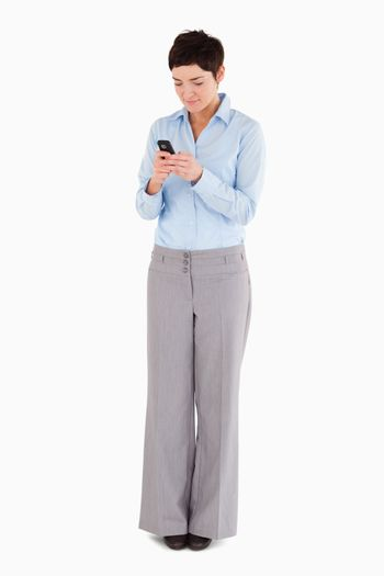 Woman dialing on her phone