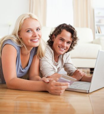 Cute couple booking their holidays online