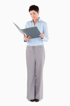 Woman looking at a binder