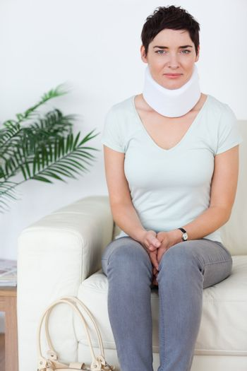 Woman with a surgical collar
