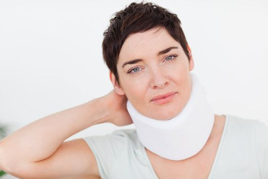 Close up of a woman with a surgical collar