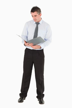Businessman looking at a binder