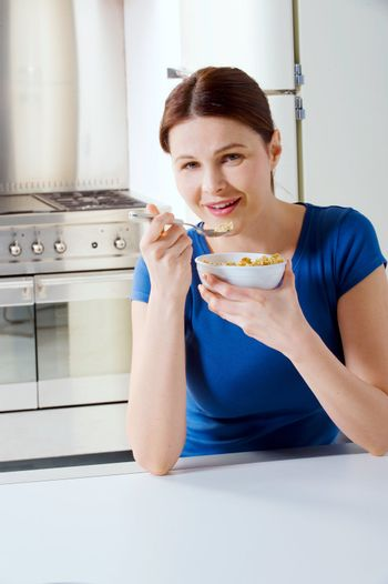 woman eating cereal with milk