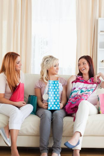 Young Women with shopping bags in a living room