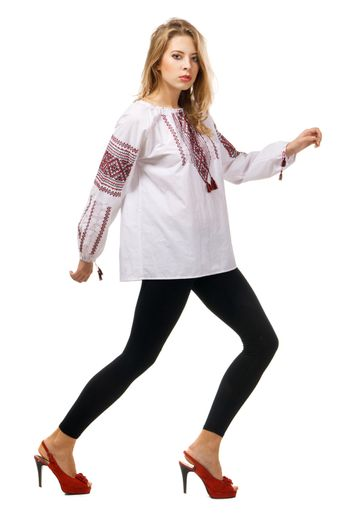 Fashionable model in a traditional slavic shirt