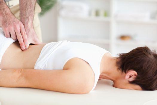 Chiropractor massaging a woman