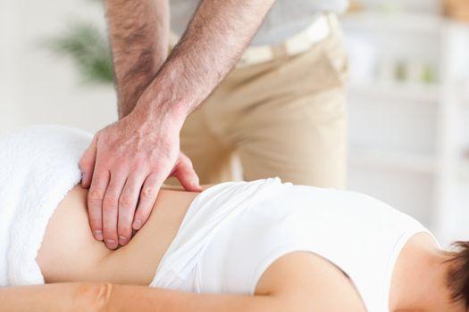 Masseur massaging a woman