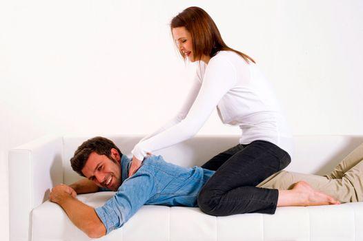 woman massaging the shoulders of man
