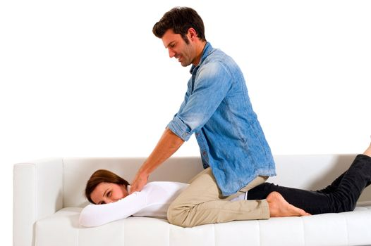 man massaging the shoulders of a woman
