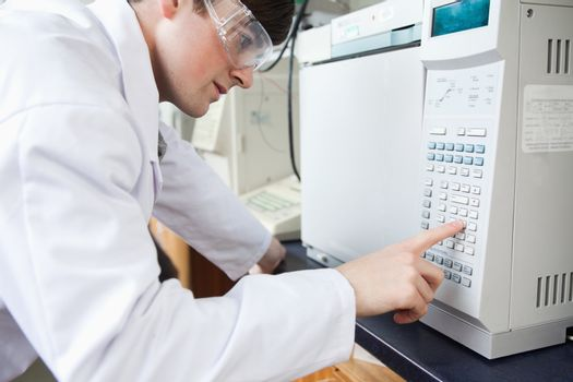 Science student using a laboratory chamber furnace in a laborato