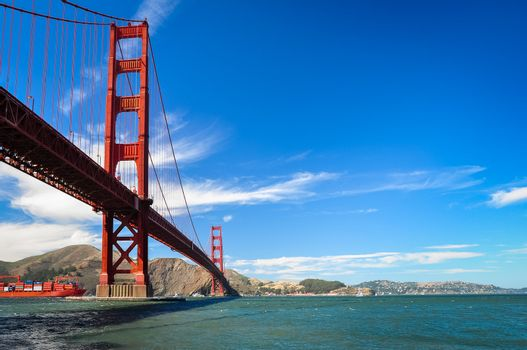 Golden Gate bridge with the cargo boat