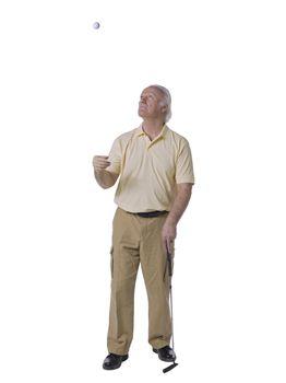 golfer tossing a ball