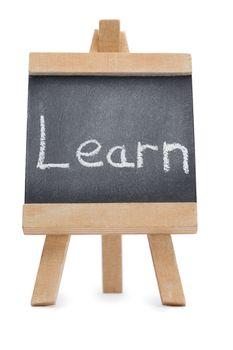 Chalkboard with the word learn written on it