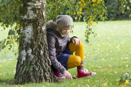 Cute girl in autumn park