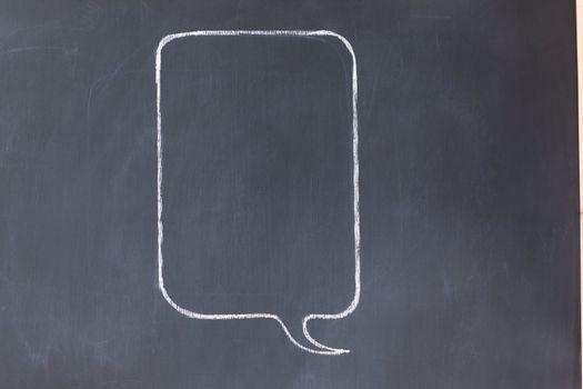 Empty rectangular comic strips balloon on a blackboard