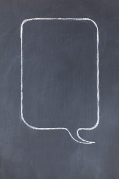 Empty rectangular speech bubble on a blackboard