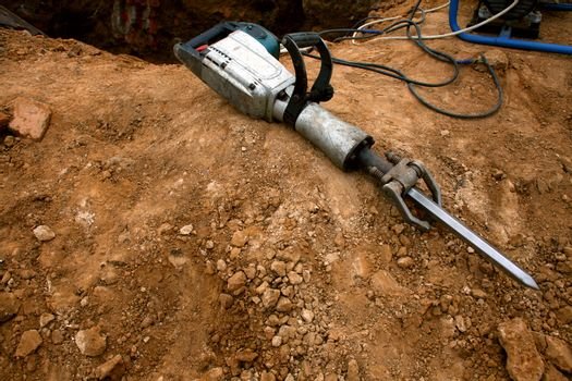 Pneumatic hammer lying on the ground