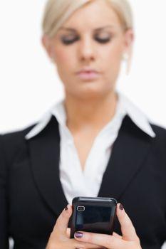 Businesswoman texting
