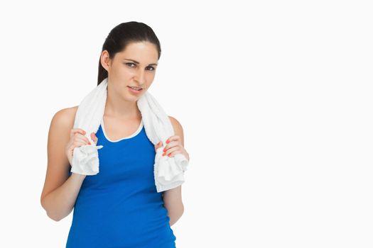 Brunette in sportswear with a towel
