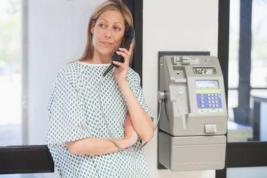 Femalepatient on hold on telephone