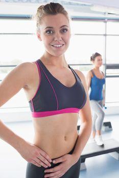 Happy woman in aerobics class