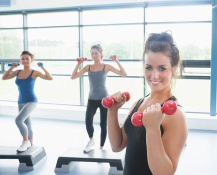 Three happy women doing aerobics