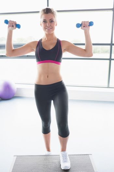 Woman lifting weights and doing aerobics