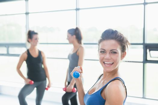 Women talking in aerobics class