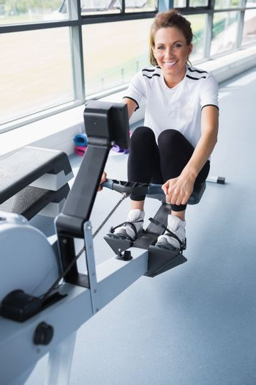 Happy woman on rowing machine