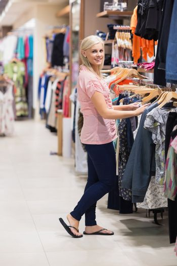 Woman is searching for clothes