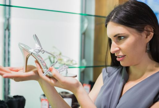 Woman looking at a shoe