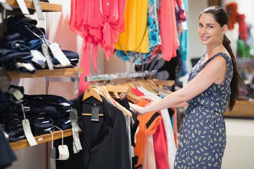Woman standing at a clothes rail
