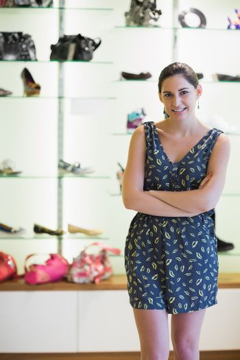 Woman standing in front of shoe display