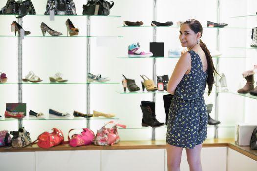 Woman  standing beside shoe display