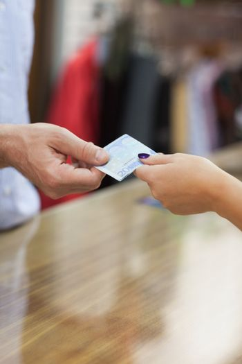 Paying with cash at counter