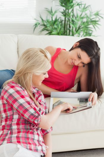 Woman looking at a catalog with friend