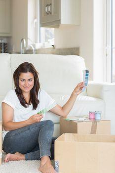 Woman deciding colour for room
