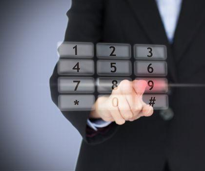 Woman pressing number on digital number pad