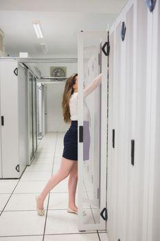 Woman reaching into servers