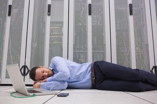 Man sleeping while doing maintenance on servers