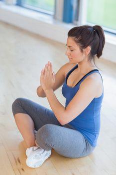 Woman meditating in easy yoga pose