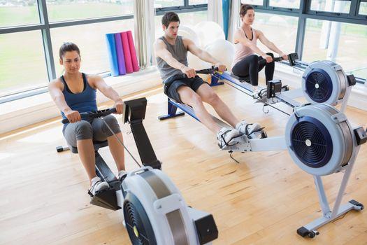People using rowing machines