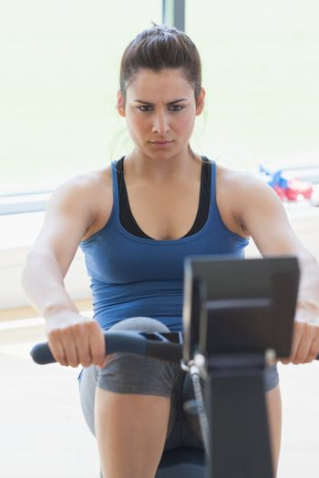 Focused woman at the rowing machine