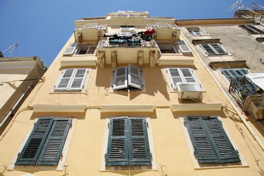 Old house in Corfu with wooden windows and balcony