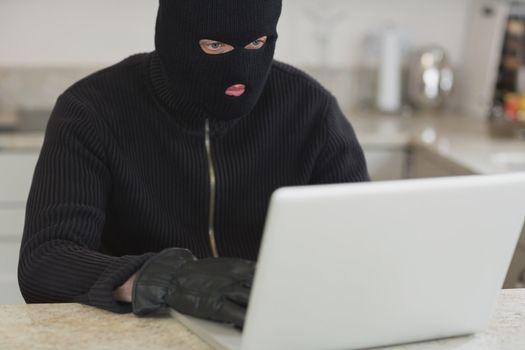 Man hacking an unknown laptop