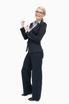 Proud businesswoman cheering
