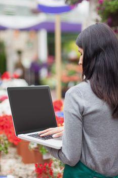 Florist using a laptop