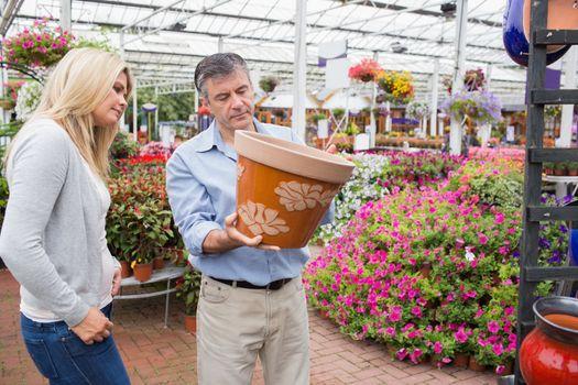 Couple deciding on flower pot