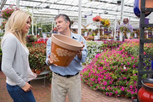 Couple deciding to buy pot